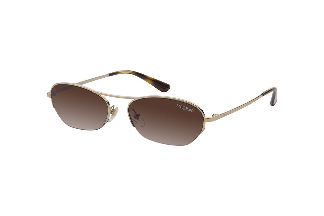 משקפי שמש של ווג מסגרת אובלית פרונט בגוון זהב זרועות בגוון זהב מנומר עדשות בגוון חום מדורג