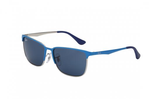 משקפיים מלבניים ממתכת,  חצי מסגרת עליונה וזרועות בצבע כחול, מסגרת פנימית  דקיקה בצבע כסף ועדשות כחולות