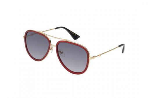 משקפי שמש מבית GUCCI בדגם טייסים נשי עם מסגרת פנימית בגוון אדום מנצנץ ומסגרת חיצונית בגוון זהב עם עדשות תואמות בגוון שחור מדורג