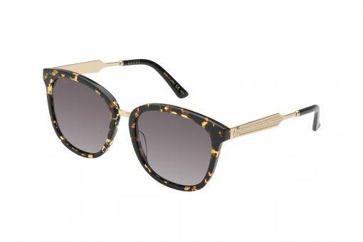 משקפי שמש מבית GUCCI בדגם נשי מרובע בגוון מנומר עם אלמנט הלוגו ועיטורים בגוון זהב בצידי הזרועות
