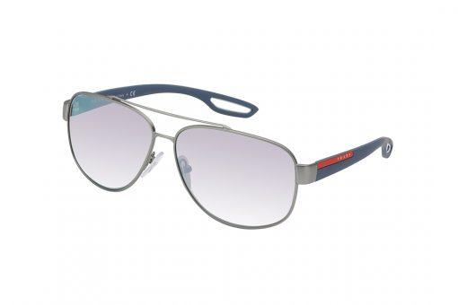משקפי שמש בקווים מרובעים, מסגרת וגשר אף כפול דקיקים בגוון ברונזה, זרועות גמישות בגוון כחול-אפרפר, עדשת מראה