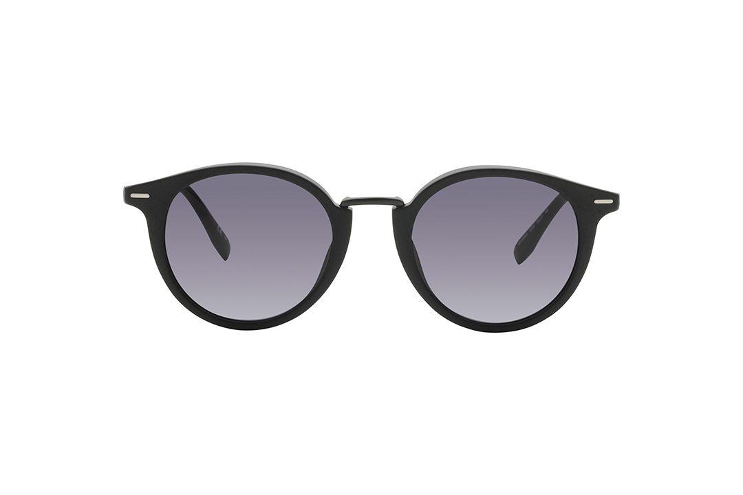 משקפי שמש יוניסקס עגולים עם פינות מעט חתוליות. מסגרת, גשר אף וזרועות המשלבים אצטט ומתכת בגימור שחור מט, עדשות בגוון אפור
