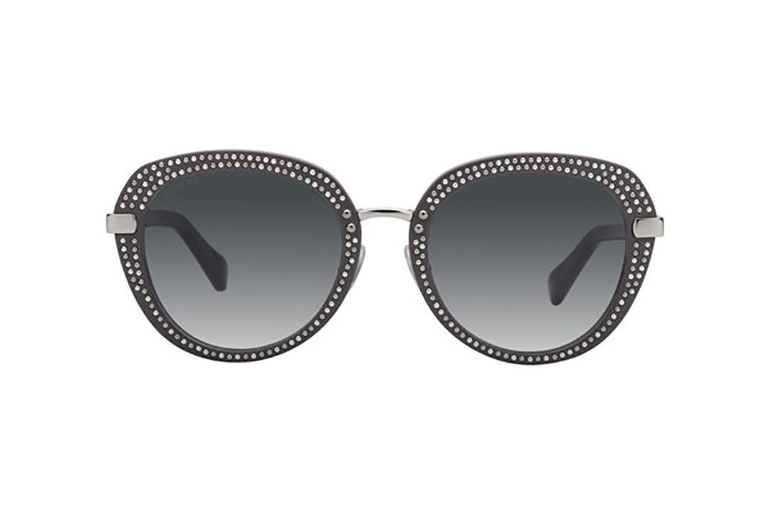 משקפי שמש מאצטט בשילוב מתכת דגם עגול נשי בגוון אפור עם ניטים עדינים בגוון כסוף ועדשות כהות