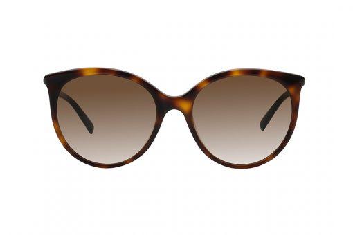 משקפי שמש אובר סייז עגולים עם פינות חתוליות. מסגרת וזרועות דקות בגימור מנומר, עדשות בגוון חום.