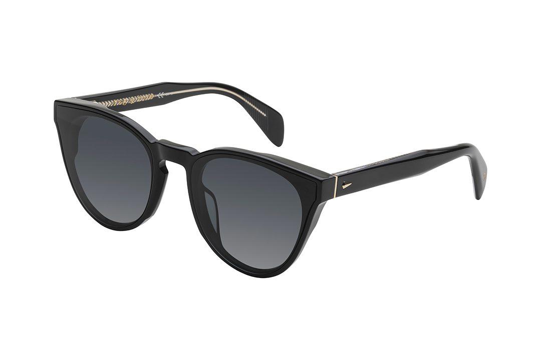 משקפי שמש עגולים עם פינות חתוליות, חזית וזרועות בצבע שחור, עיטורים עדינים ומינימליסטיים בגוון זהב על הזרועות ועדשות בצבע אפור