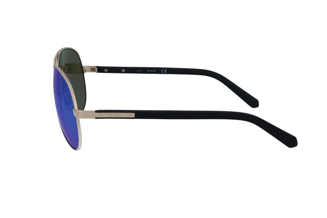 משקפי שמש מבית Guess בדגם טייסים בגוון זהב ועדשות מראה בגוון כחול