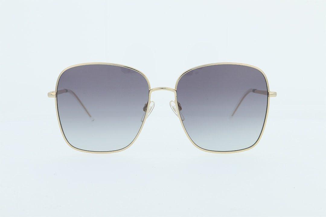 משקפי שמש מבית Tommy Hilfiger בדגם אובר סייז מרובע בגוון זהב ועדשות בגוון כחול מדורג