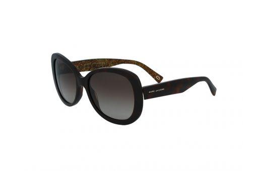 משקפי שמש מבית Marc Jacobs בדגם אובר סייז מרובע בגוון חום עם נצנצים זהובים כלפי פנים ועדשות בגוון חום