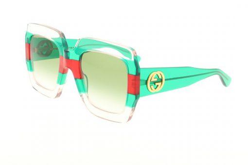 משקפי שמש מבית Gucci בדגם אובר סייז מרובע בגווני שקוף-אדום-ירוק עם לוגו המותג בצידי הזרועות