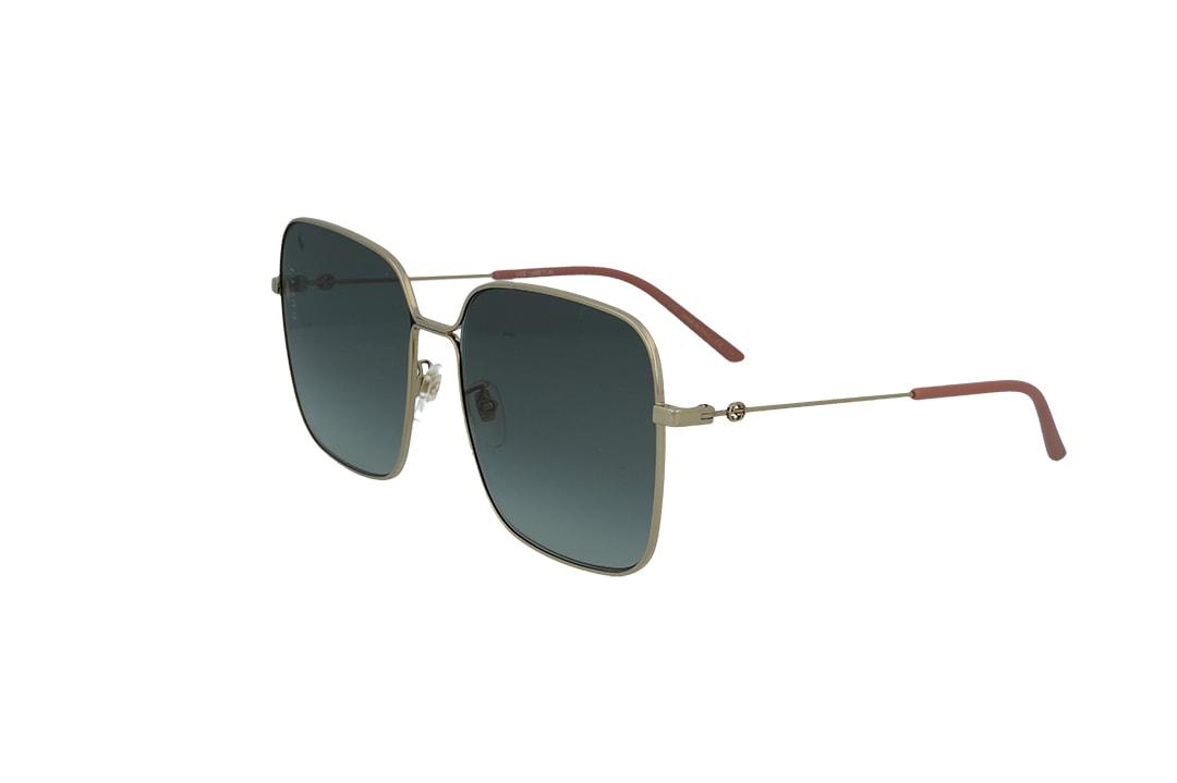 משקפי שמש מבית Gucci בדגם אובר סייז מרובע בגוון זהוב ועדשות בגוון כחול כהה