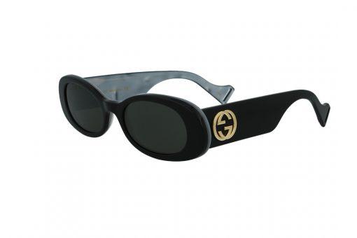 משקפי שמש GUCCI הדגם האייקוני בעל מסגרת אובלית בעל עיטורים פנימיים ואלמנט הלוגו בגוון זהב
